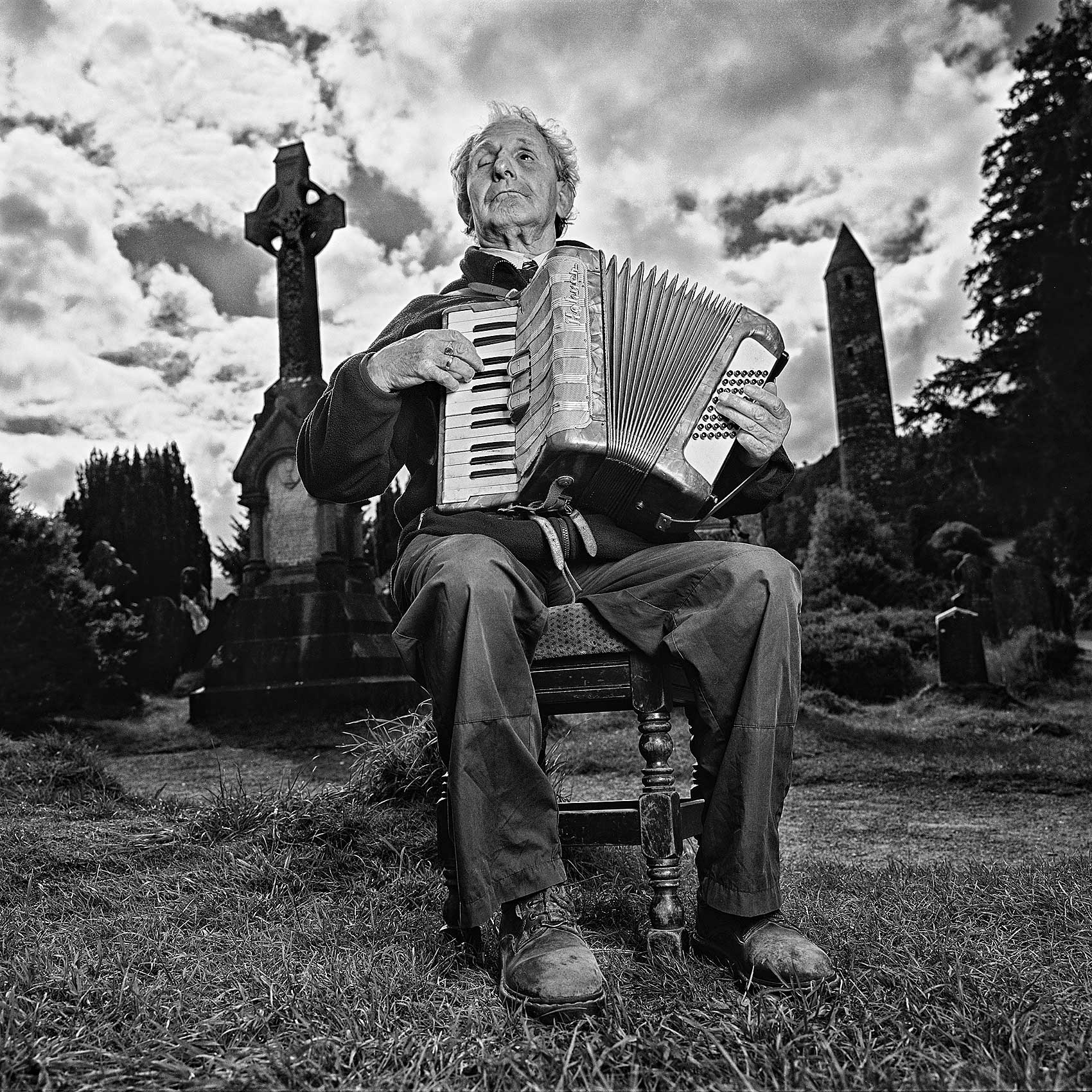 an-old-blind-irish-man-plays-the-accordion-in-a-graveyard