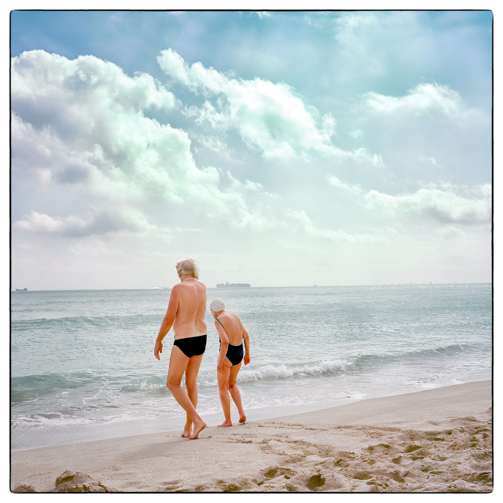 an-old-couple-go-for-a-swim-on-miami-beach-florida