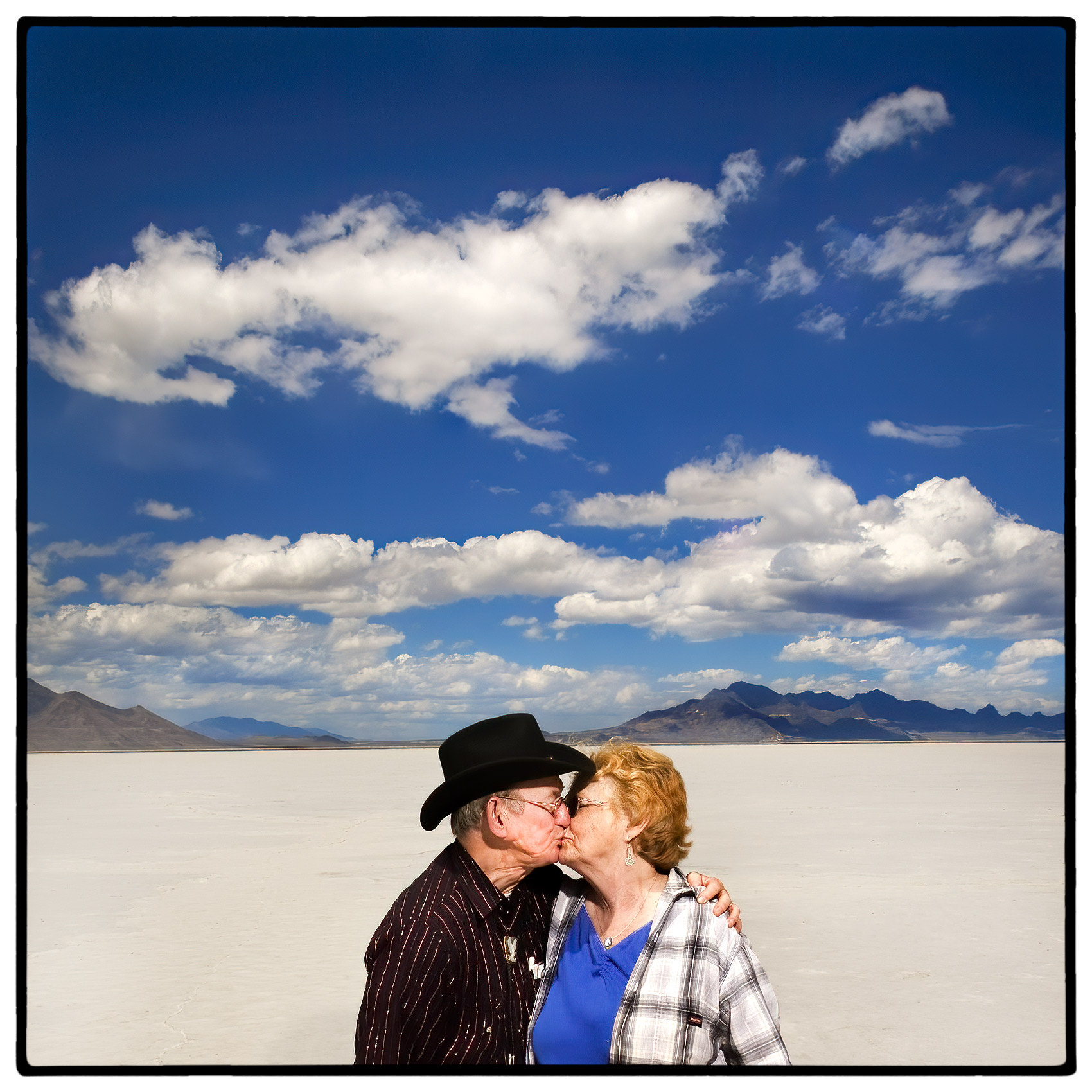 an-old-couple-kissing-in-the-scenic-bonneville-salt-flats