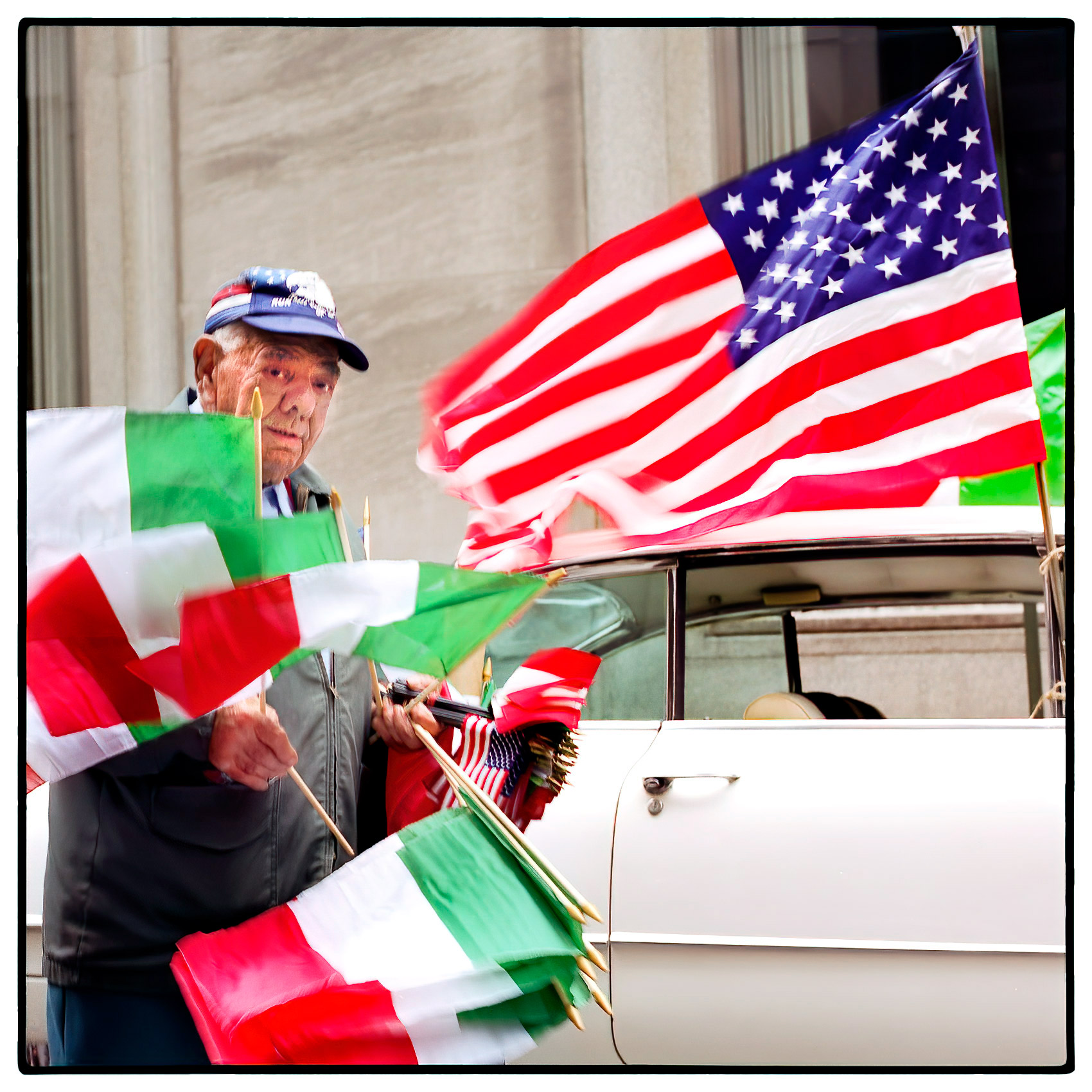 an-old-man-selling-flags-on-the-streets-during-the-new-york-thanksgiving-parade