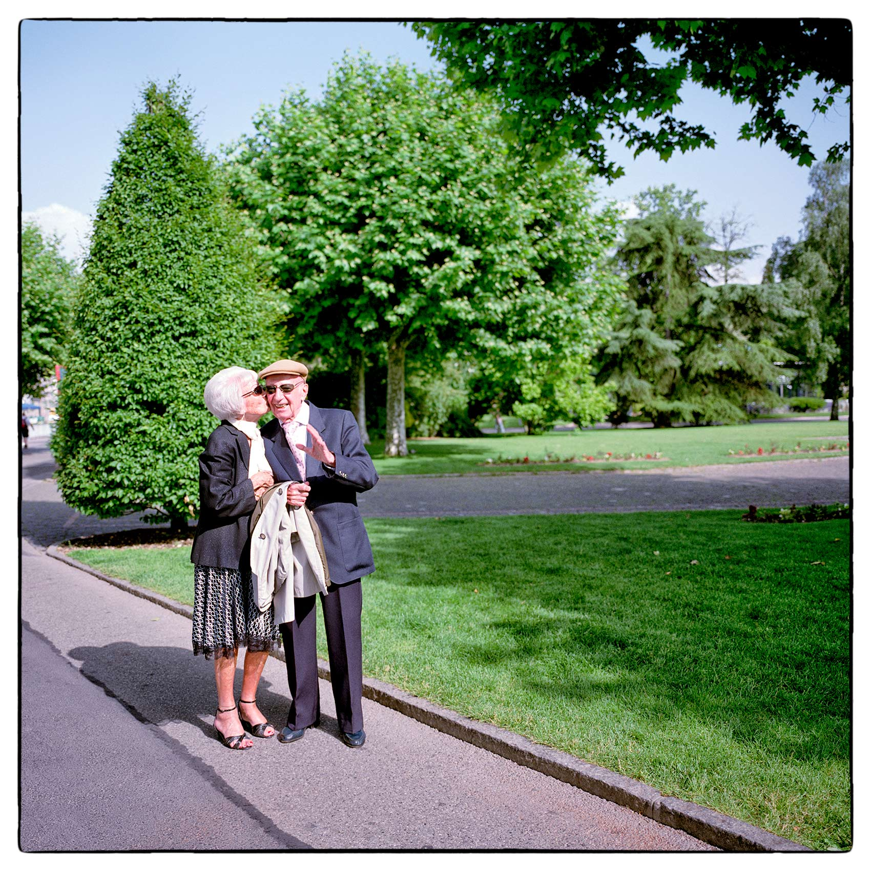 an-older-couple-enjoy-each-others-company-as-the-walk-through-a-park-in-geneva-switzerland