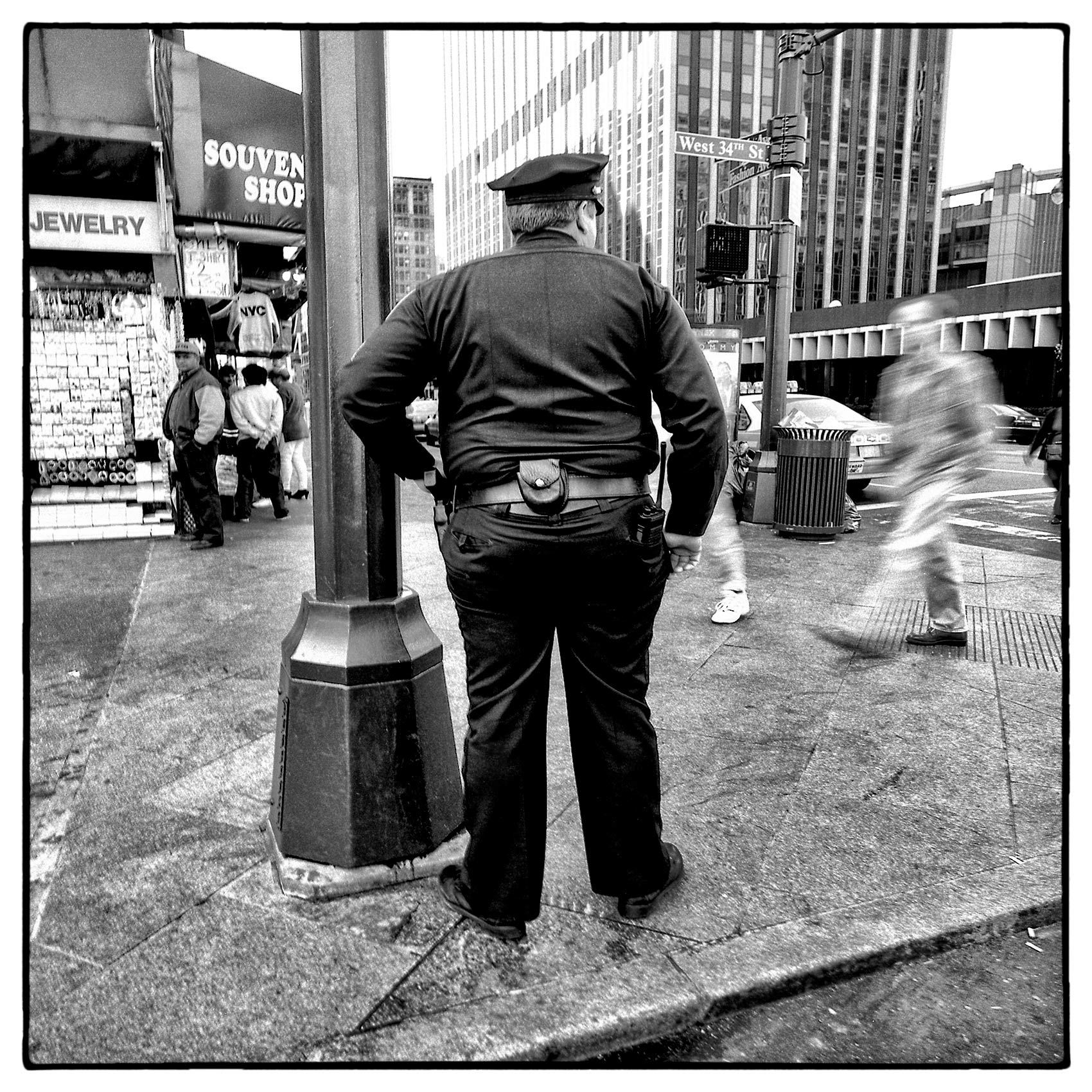 an-overweight-new-york-city-police-officer-patrols-34th-street-in-manhattan