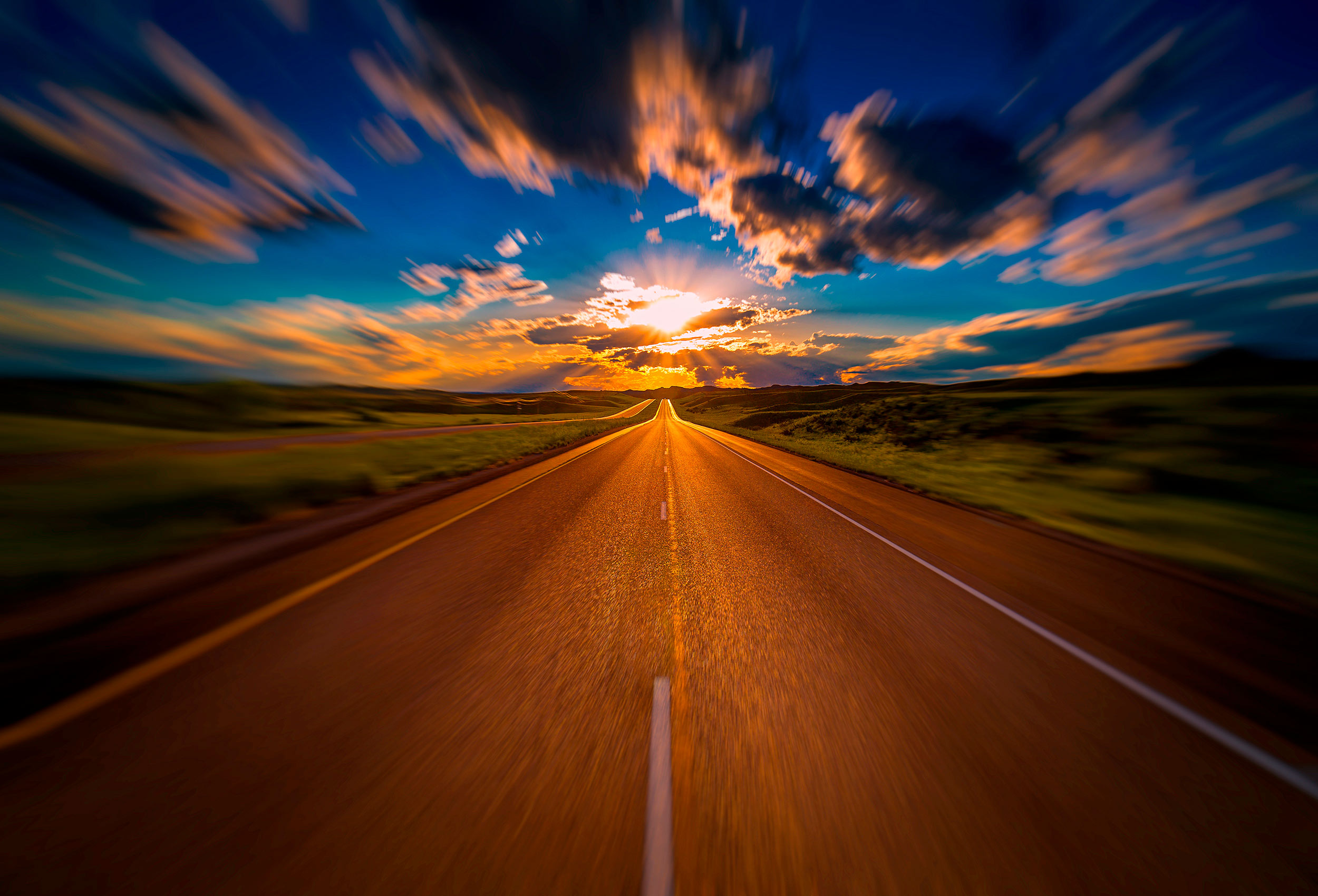 an incredible sun sets over a highway in south dakoka by an award winning travel photographer