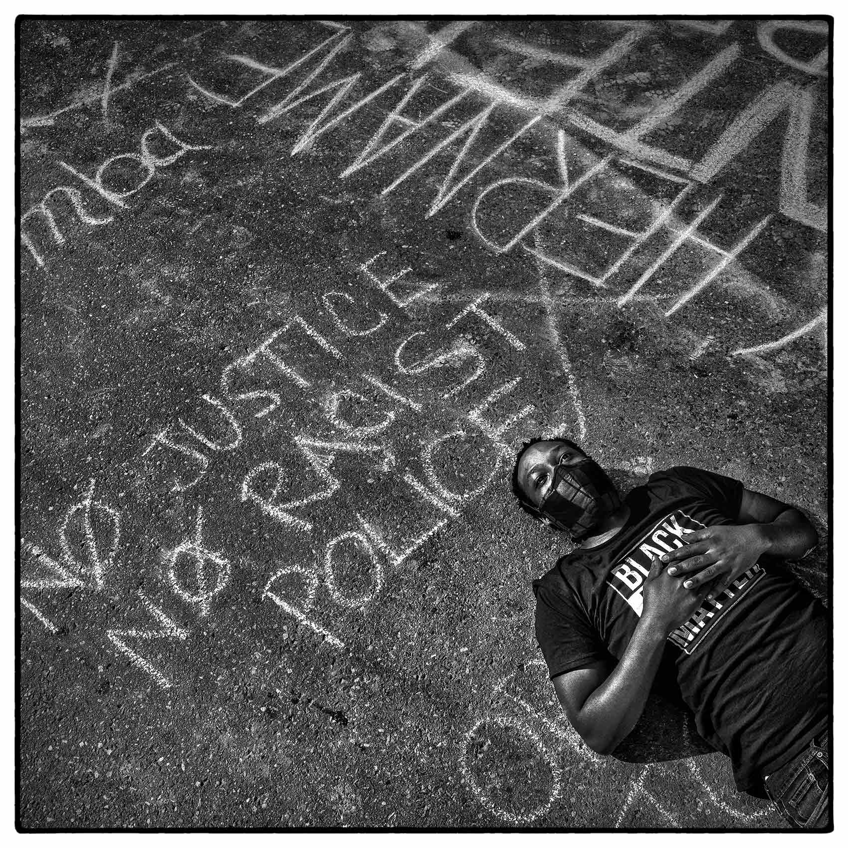 a-black-lives-matter-protestor-lays-on-the-street-in-toronto-during-a-protest