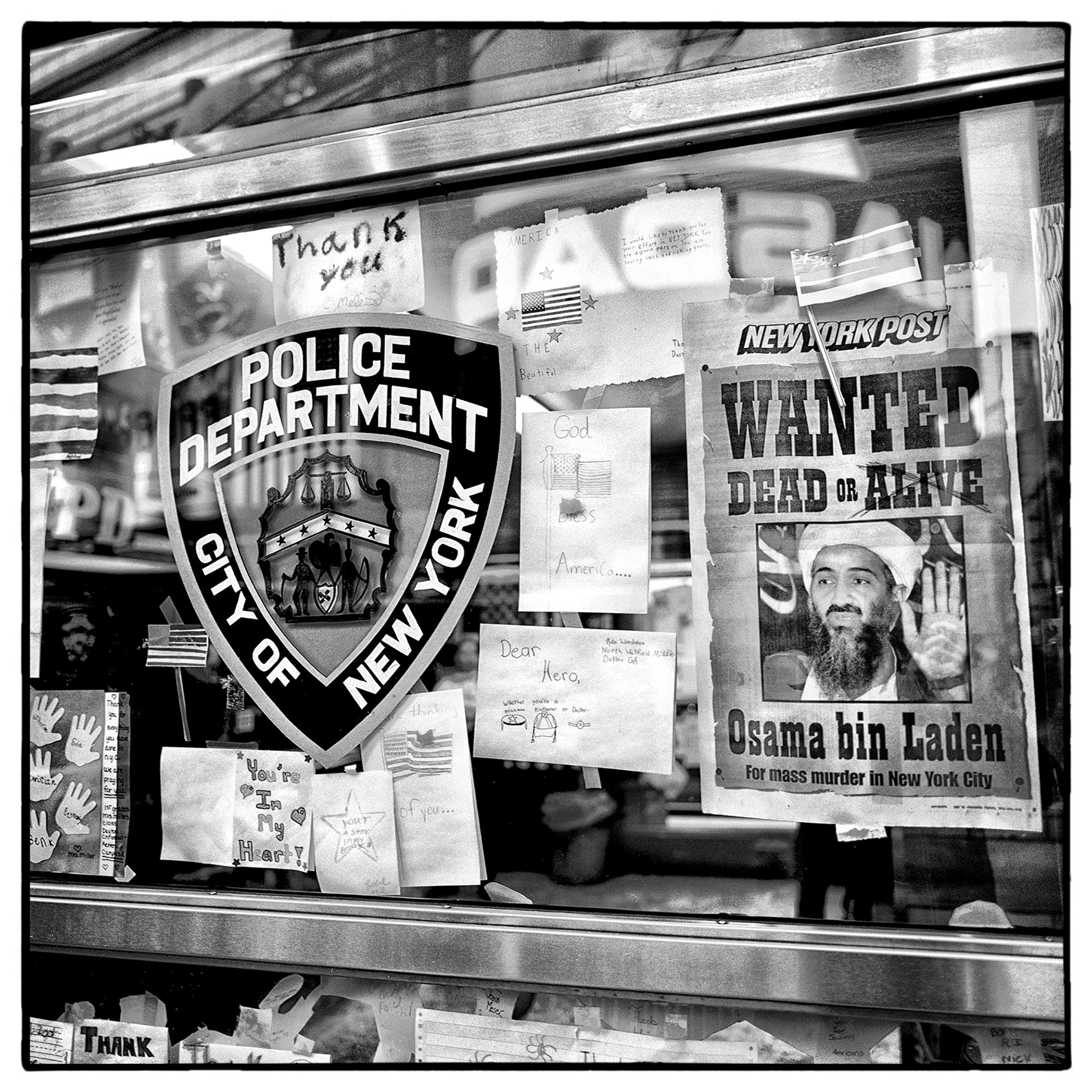 childrens-letters-and-a-osama-bin-laden-wanted-poster-are-posted-in-the-nypd-times-square-office-after-911