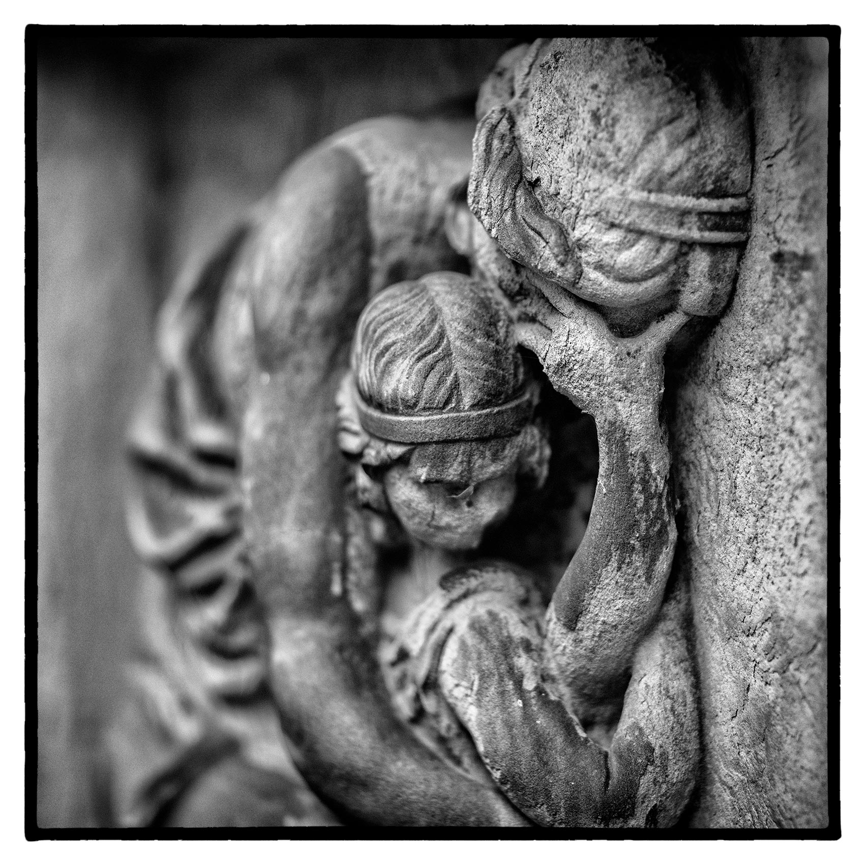 a stone sculpture of-crying mother and baby at St. James Cemetery in Toronto