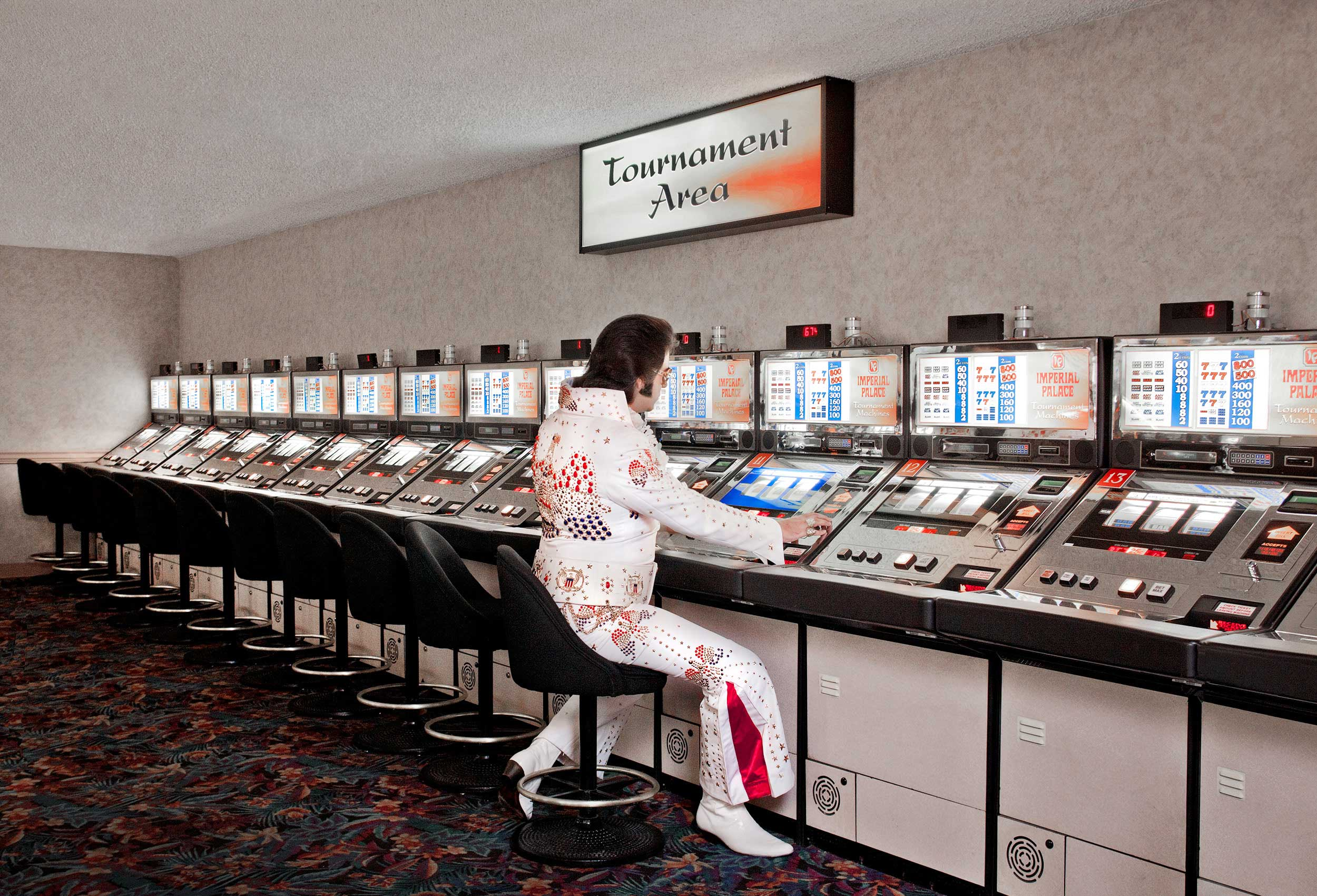 an elvis impersonator plays the slot machines in las vegas