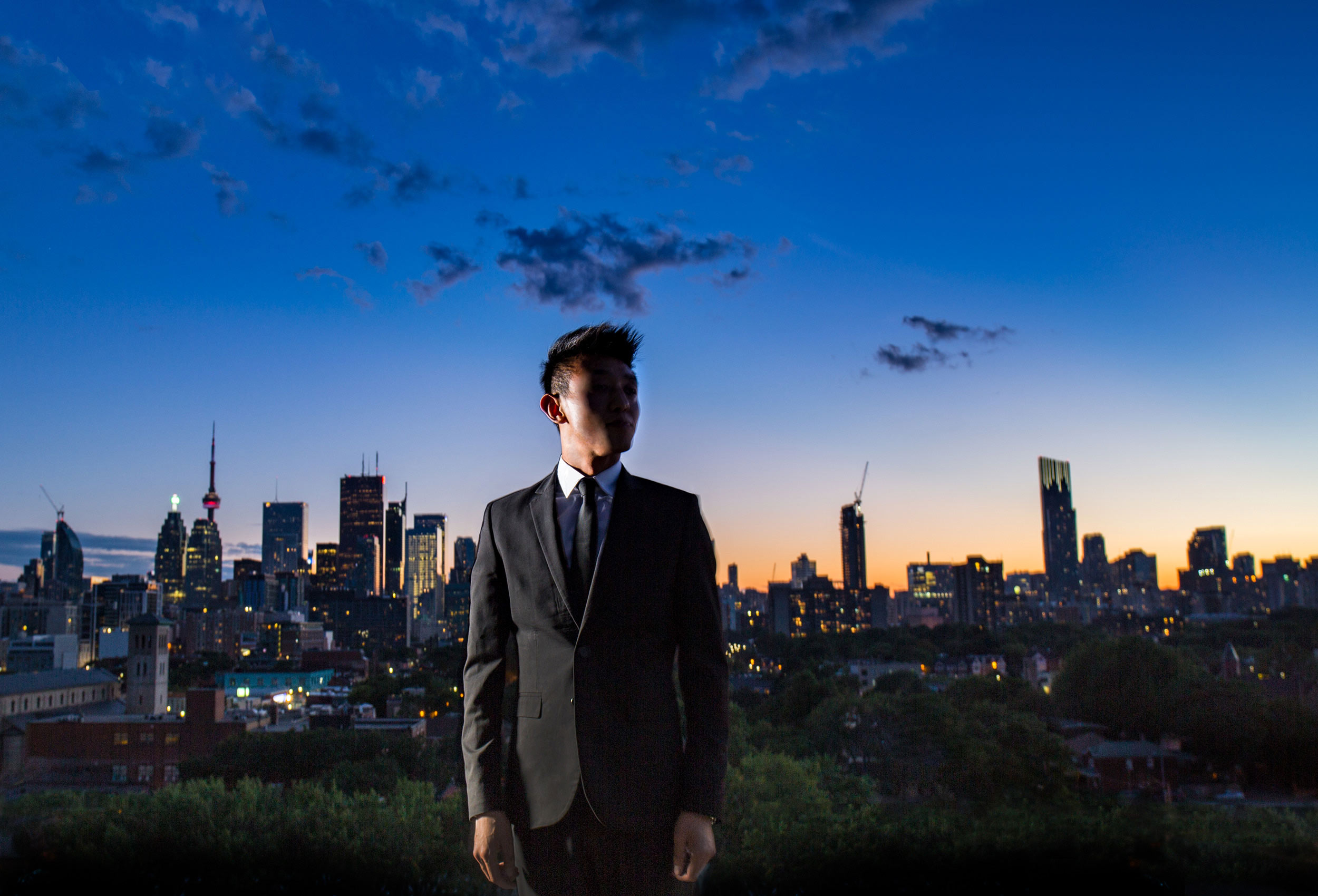 handsome-man-with-toronto-skyline-at-dusk-by-photographer-John-Hryniuk