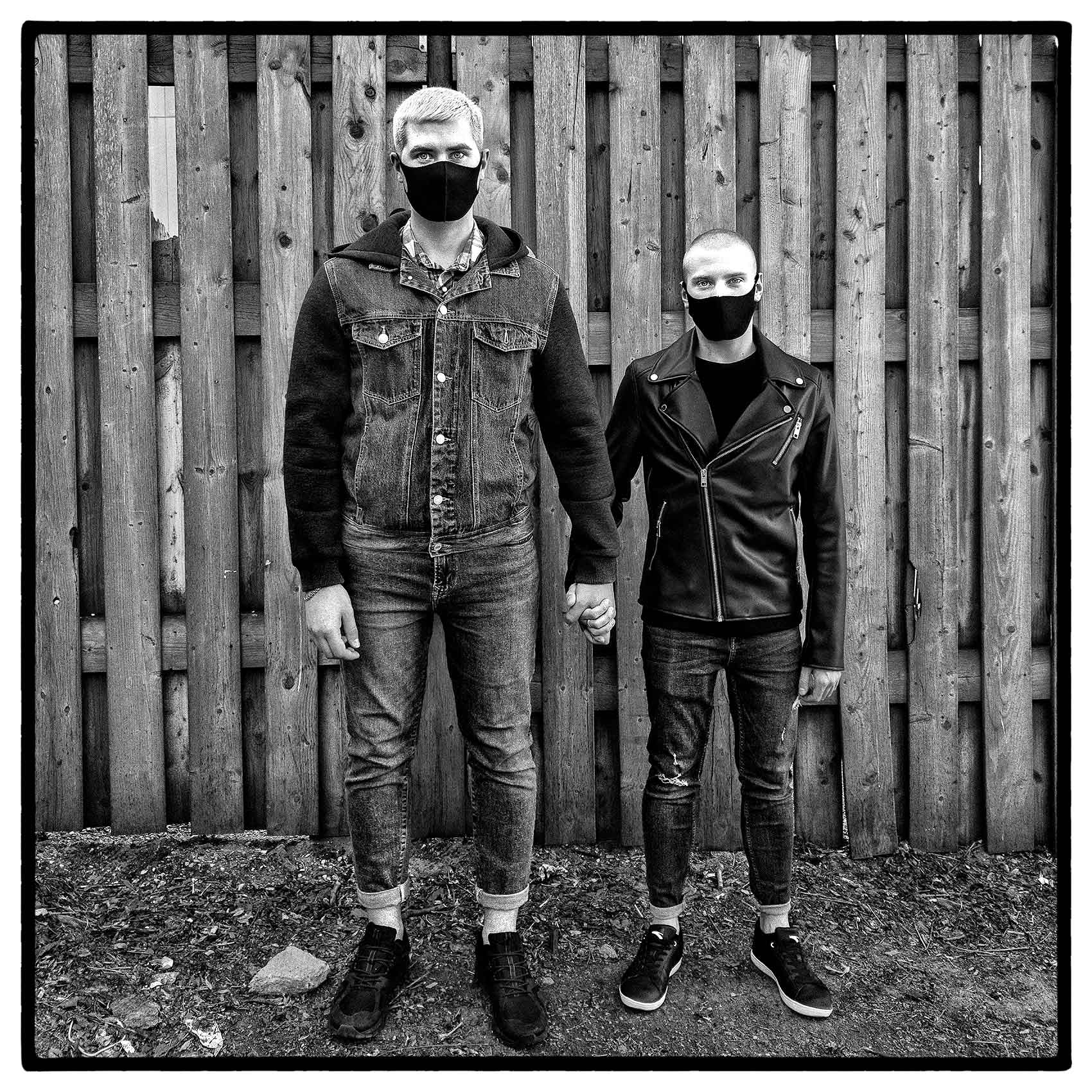 portrait-of-a-gay-male-couple-wearing-facemasks-during-the-pandemic-by-Toronto-portrait-photographer-John-Hryniuk