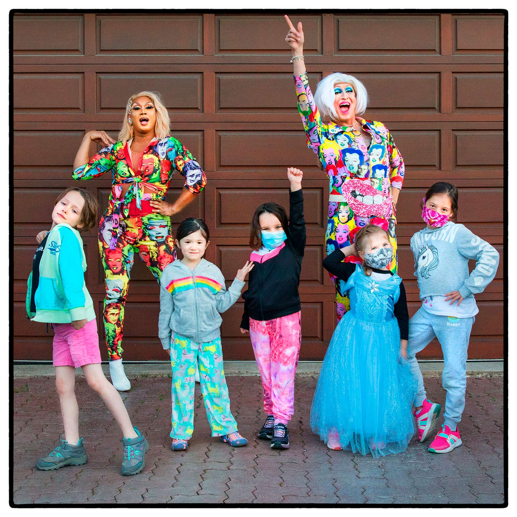 drag queens in suburban Toronto pose with children after performing in north york