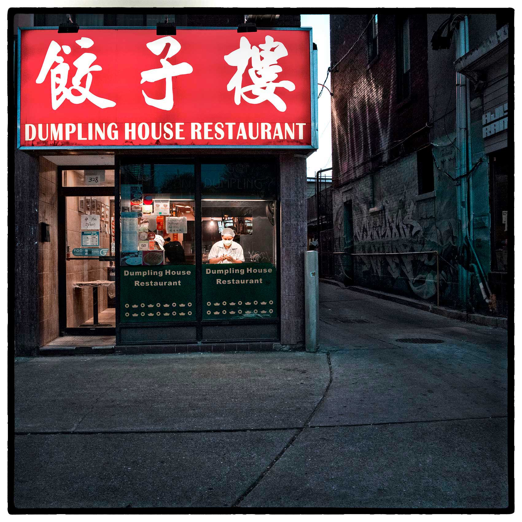 a-chef-wearing-a-mask-at-the-dumpling-house-restaurant-in-Torontos-Chinatown