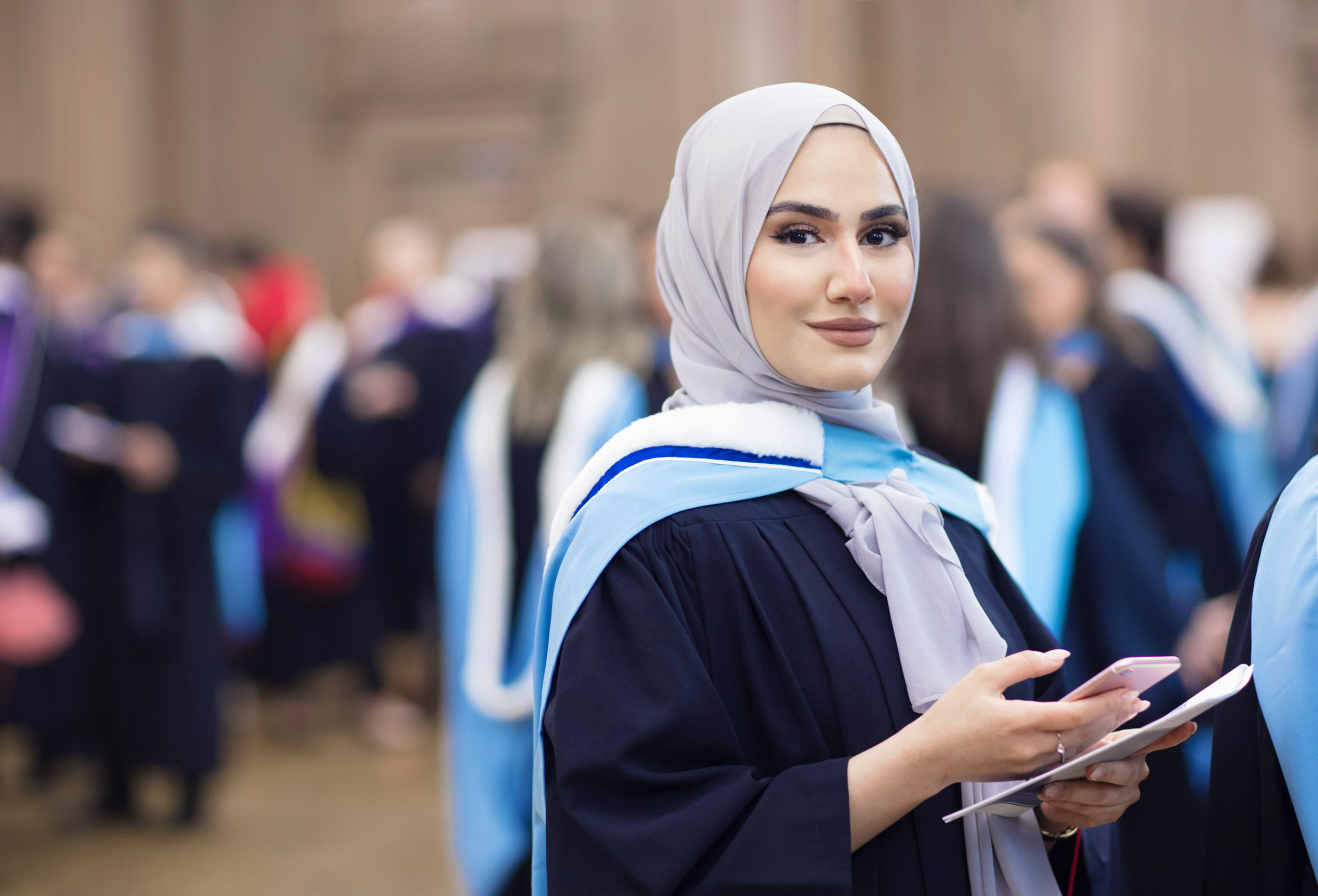a muslim university student smiling on her graduation day at the university of toronto