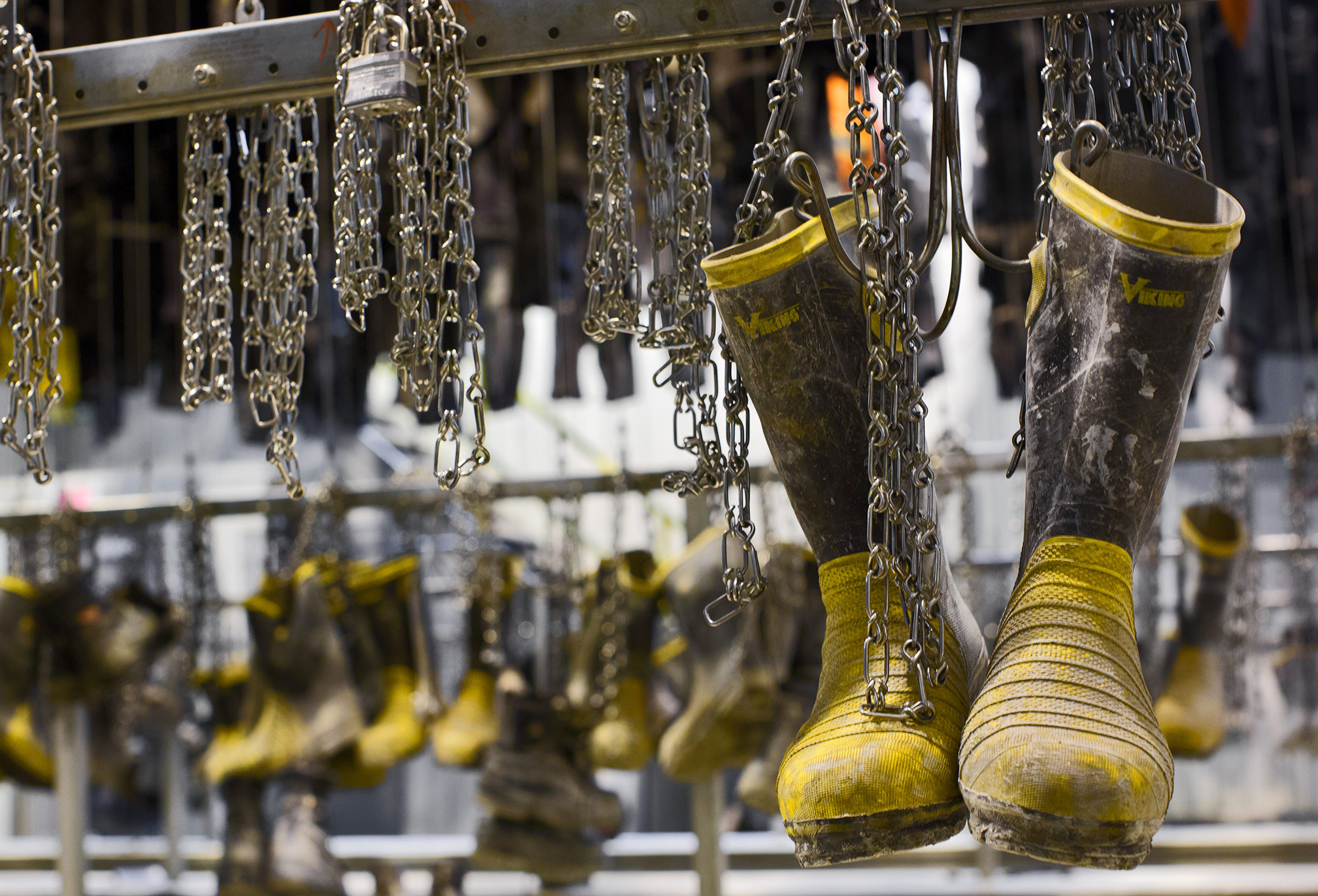 mining boots hang at an iamgold plant in Rouyn quebec by the best canadian mining photographer john hryniuk