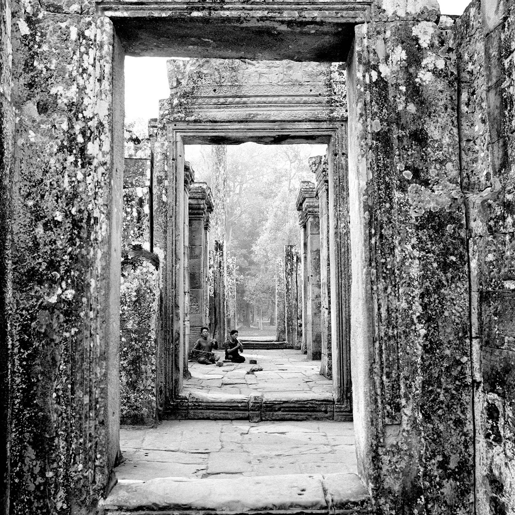 two-men-both-missing-their-legs-from-landmines-busk-inside-angkor-wat-temple-in-cambodia