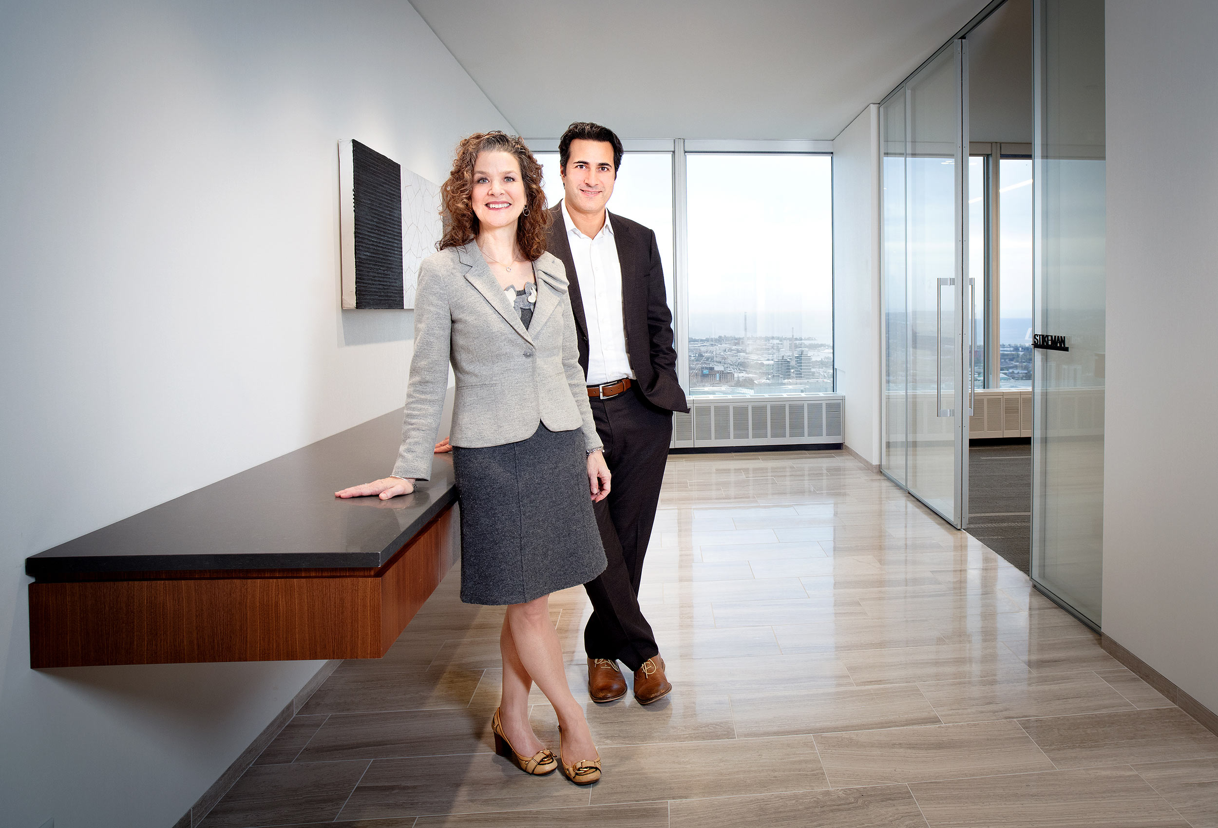 two lawyers pose for a portrait in their toronto offices for canadian lawyer magazine